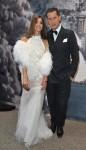 Os editores Carine Roitfeld, em Givenchy, e Stefano Tonchi